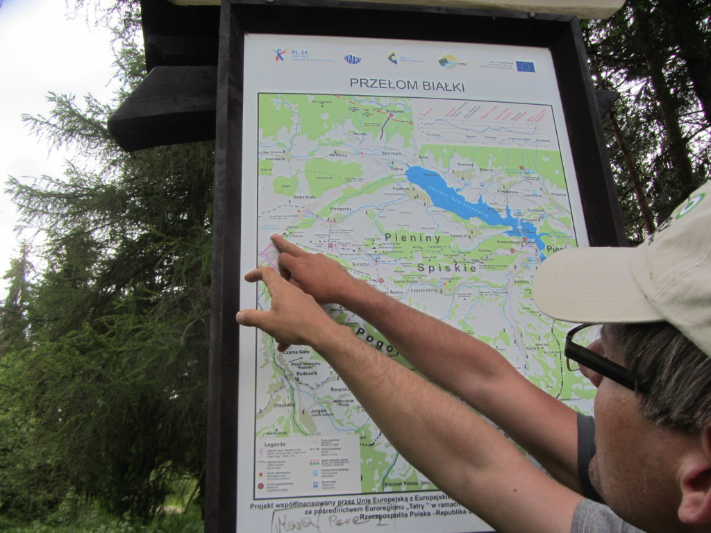 Szymon and Shemek pointing out where we are on the map