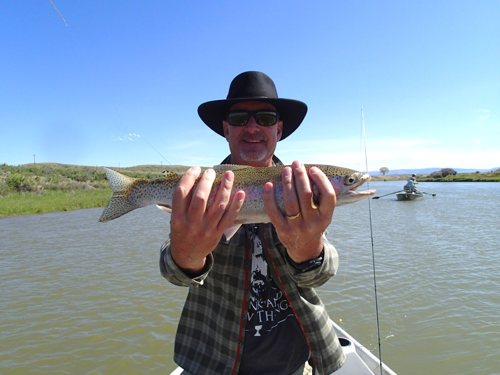 "Expert Angler Bill Scripps with just another of his many 16"" - 20"" rainbows"