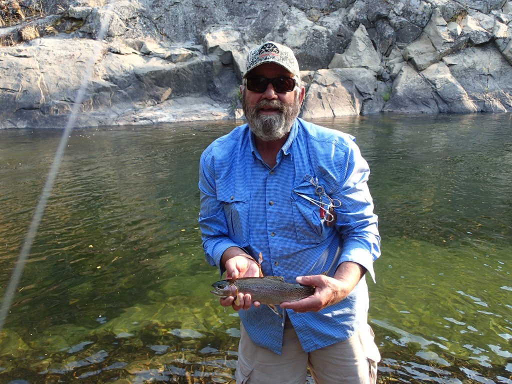 "Mike with a nice Kern River Rainbow caught right in front of the ""infamous"" Huckaby primitive camp site"