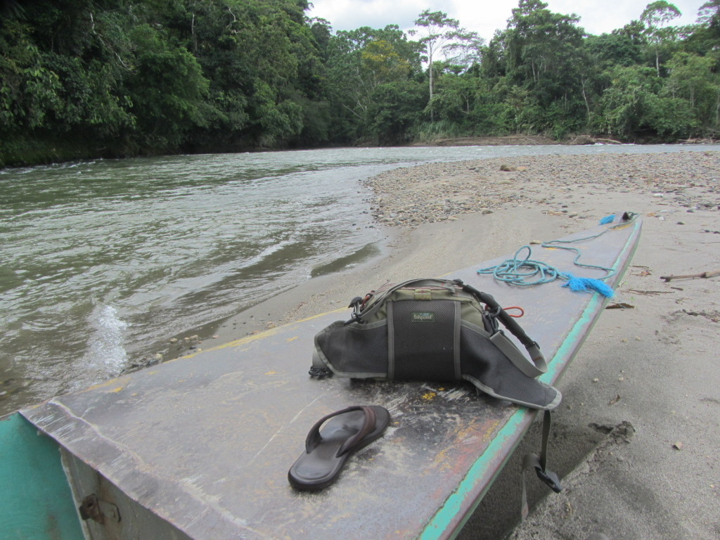 My lone remaining sandal along with my fly fishing bag on the ponga.